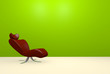Modern red chair on a green wall