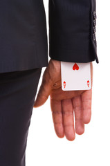 Businessman with ace card hidden under sleeve.