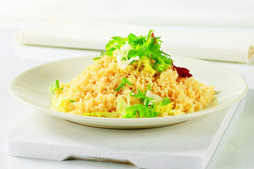 Couscous with salad greens
