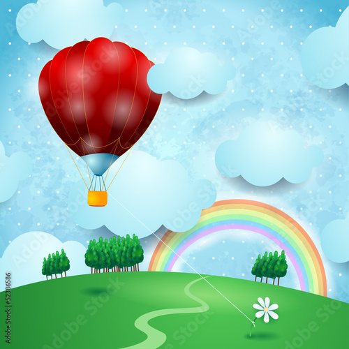 Hot air ballon on fantasy landscape