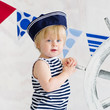 Cute little boy in the striped vest and sailor hat