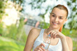 Smile young beautiful woman holding drink water