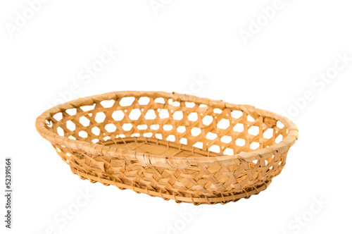 An empty wicker dish on white background