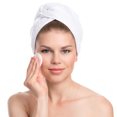 Skin care woman. Pretty model removing makeup, isolated