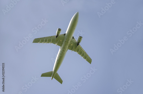 Bottom view of airplane taking off