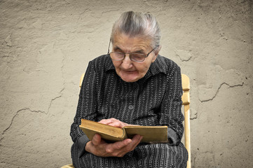 Elderly woman reading Bible