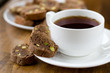 Cup of tea and biscotti. Selective focus.