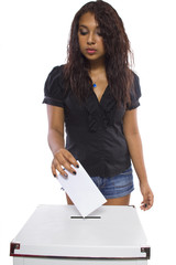 Latin female voter at the ballot box.