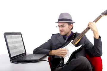 Guitarist looking at tablature online.