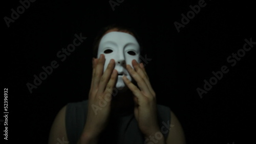 Man with scary mask over black background