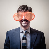 funny businessman with big orange glasses