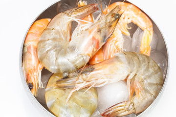Shrimps or Prawns in bowl  on ice. Above view