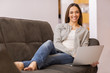 Relaxed woman on sofa with her laptop
