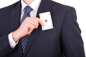 Businessman putting ace card in his pocket.