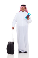 middle eastern man with  luggage and air ticket
