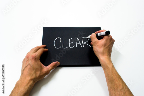 "two hand writing ""clear"" on a black background"