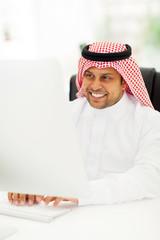 arabic businessman working on computer