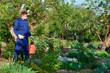 Male gardener protecting plant