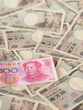 Chinese yuan note isolated on Japanese yen note background