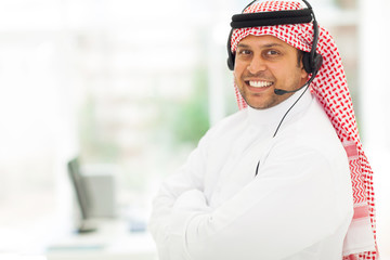 arabian IT support worker with headphone