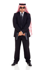 arabian bodyguard holding handguns