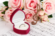 Treble clef, roses and box holding wedding ring