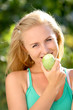 beautiful happy smiling woman with green apple