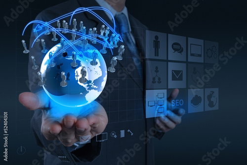 businessman hand working with new modern computer show the earth
