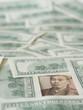 10000 Japanese yen note isolated on US dollar note background