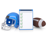 Checklist, football helmet and ball