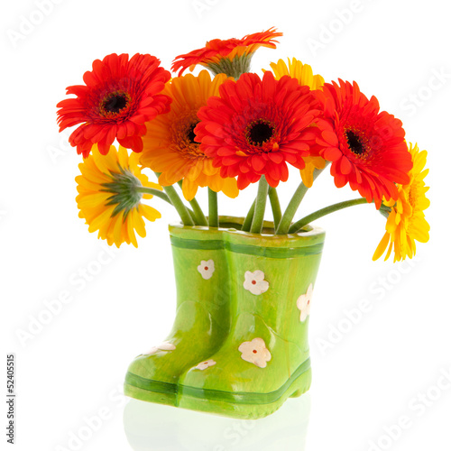 Gerber flowers in green boots