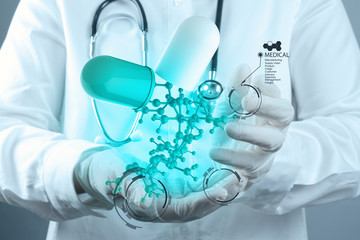 scientist doctor hand holds virtual molecular structure in the l