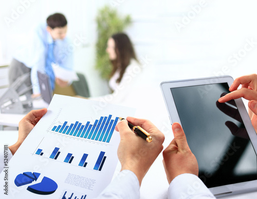 busienssman holding digital tablet in office