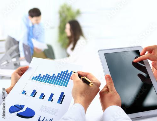 busienssman holding digital tablet in office