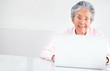 Old woman using a computer