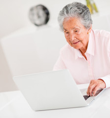 Senior woman using a laptop
