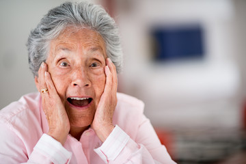 Surprised elder woman