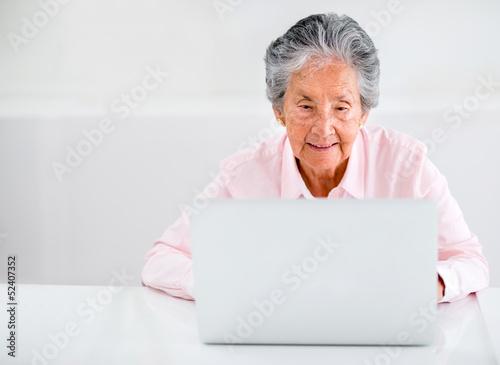 Elder woman using a laptop