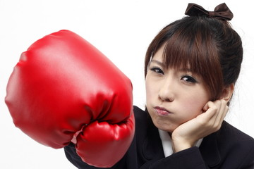 Office lady is tired of working and plays boxing for fun.