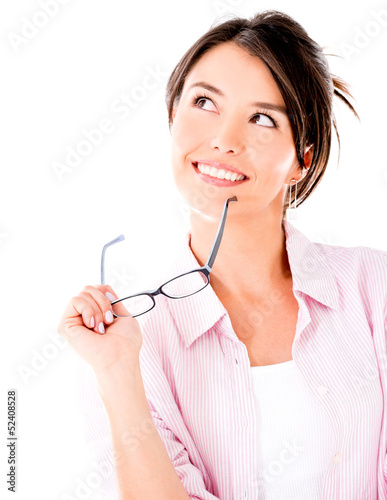Thoughtful woman holding glasses