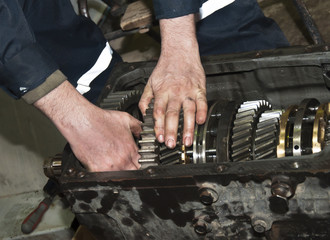 worker repairs transmission