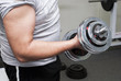 the guy lifts a dumbbell, is photographed by a close up