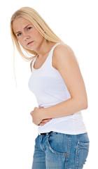 Junge Frau klagt über Bauchschmerzen