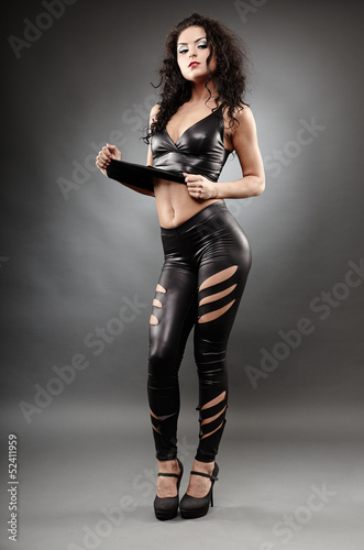 Sexy woman posing in leather suit