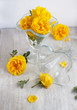goblets and bunch of flowers - yellow roses