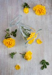 top view on the glass and yellow roses