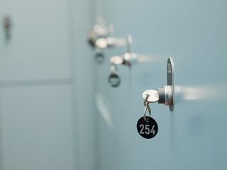 Many lockers with keys on locker room
