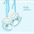 Baby shower card with blue booties and lace