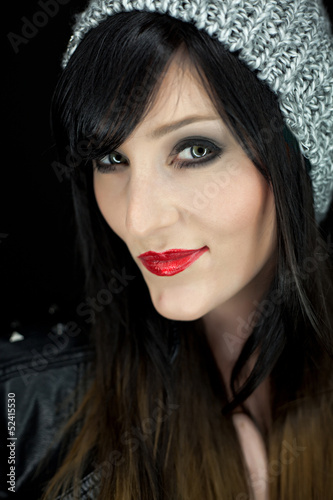 Portrait of a bautiful young woman with red lipstick and grey ha