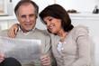 Couple reading newspaper